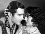 Bebe Daniels Ready to Kiss the Man in Polka Dot Collar Shirt while Holding His Head Photo by  Movie Star News