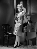 Gloria DeHaven Leaning On A Table in Formal Dress in Black and White Photo by  Movie Star News