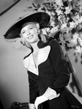 Carole Landis on a Hat and Dress Photo by  Movie Star News