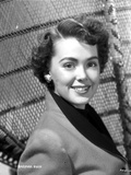 Barbara Rush posed in Coat with Silver Earrings Photo by  Movie Star News