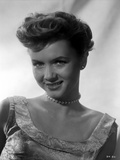 Debbie Reynolds smiling in White Dress with Pearl Choker Photo by  Movie Star News