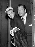 Cyd Charisse smiling and Holding a Book and a Jacket Photo by  Movie Star News