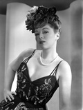 Claire Trevor Posed in Black Corset with Floral Hat Photo by  Movie Star News