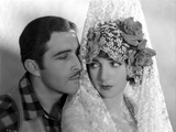 Bebe Daniels Close Up Portrait with Partner Actor in White Linen Shawl with Flowers Photo by  Movie Star News