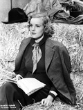 Frances Farmer on Suit and sitting on a Hay Photo by  Movie Star News