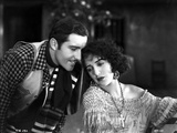 Bebe Daniels Leaning Back Her Head on the Man's Shoulder in Knitted Dress Photo by  Movie Star News