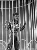 Debbie Reynolds standing Behind Bars in Plaid Sleeves Photo by  Movie Star News