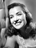 Ella Raines smiling in Classic Photo by  Movie Star News