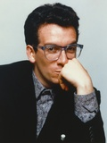 Elvis Costello Leaning Chin On Hand in Black Tuxedo Photo by  Movie Star News