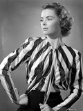 Dorothy McGuire on Stripe Top sitting and Hand on Waist Photo by  Movie Star News
