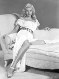 Gloria Grahame Leaning on Couch in White Dress Photo by  Movie Star News