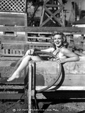 Claire Trevor smiling in Lingerie while Holding Water Hose Photo by  Movie Star News