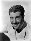 Don Ameche in White Portrait Photo by  Movie Star News