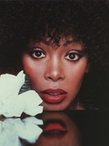 Donna Summer Putting Her Head on the Table Photo by  Movie Star News