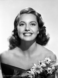 Cyd Charisse smiling in Black Dress with Flowers Photo by  Movie Star News