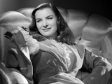 Ella Raines Seated in Robe Photo by  Movie Star News