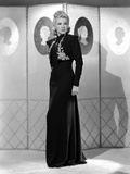 Claire Trevor standing in Black Dress Photo by  Movie Star News