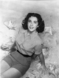 Elizabeth Taylor Looking Up in Blouse Photo by  Movie Star News
