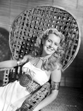 Brenda Joyce sitting on a Handcrafted Chair and smiling Photo by  Movie Star News