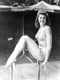 Esther Williams smiling and Seated in Swimsuit Photo by  Movie Star News