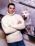 Due South Posed in White Sweater with Dog Photo by  Movie Star News