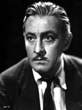 John Barrymore wearing a Suit with a Necktie in a Close Up Portrait Photo by  Movie Star News