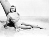 Esther Williams sitting Under The Tree in Black and White Photo by  Movie Star News