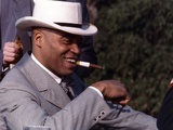 James Jones Close Up Portrait in Grey White Moire Suit and White Velvet Brimmed Hat with Cigar on t Photo by  Movie Star News