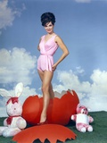 Gila Golan Posed in Pink Dress with Clouds Background Portrait Photo by  Movie Star News