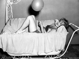 Eva Gabor Lying with a Balloon Photo by  Movie Star News