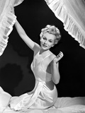 Eva Gabor on Silk Dress sitting on Bed Photo by  Movie Star News