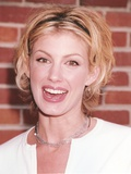 Faith Hill smiling with Red Background Photo by  Movie Star News