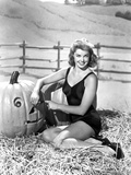 Esther Williams Seated in Hay Photo by  Movie Star News