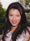 Kelly Hu smiling - smiling in a Portrait wearing Silver Silk Dress Photo by  Movie Star News