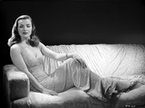 Ella Raines Reclining in Classic Dress Photo by  Movie Star News