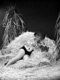 Eva Gabor on a Silk Top Lying on Hay Photo by  Movie Star News