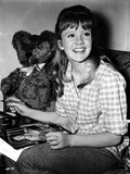 Hayley Mills wearing a Checkered Polo Shirt with Stuffed Toy Photo by  Movie Star News