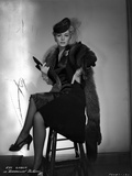Eva Gabor on a Furry Shawl and Dark Dress sitting Photo by  Movie Star News