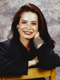 Holly Combs sitting in Black Blouse Photo by  Movie Star News