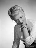 Judy Holliday on a Long Sleeve Polo sitting and smiling Photo by  Movie Star News