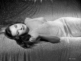Ella Raines Lying in Classic Photo by  Movie Star News