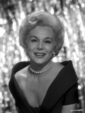 Eva Gabor on a V Neck Dress and smiling Photo by  Movie Star News