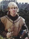 Jason Connery as Young Merlin in Merlin TV Movie in Dirty White Sleeveless Tunic and Black Leather  Photo by  Movie Star News