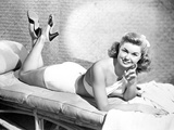 Esther Williams Lying on a Couch in White Dress smiling Photo by  Movie Star News