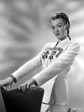 Eve Arden on White Long Sleeve Kneeling on Chair Portrait Photo by  Movie Star News