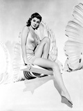 Esther Williams sitting on a Dive Board in Black and White Photo by  Movie Star News