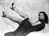 Faith Domergue Laid Down in Black Dress and Black Sandals Photo by  Movie Star News