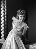 Gloria DeHaven smiling in White Dress in Black and White Photo by  Movie Star News