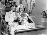 Eddie Cantor standing in White Suit With Dog Photo by  Movie Star News