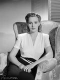 Frances Farmer on a V-Neck Top sitting on a Sofa Portrait Photo by  Movie Star News